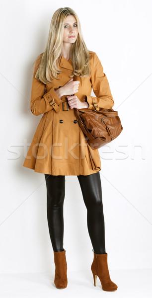 Piedi donna indossare cappotto alla moda rosolare Foto d'archivio © phbcz