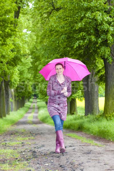 Kadın şemsiye bahar geçit Stok fotoğraf © phbcz