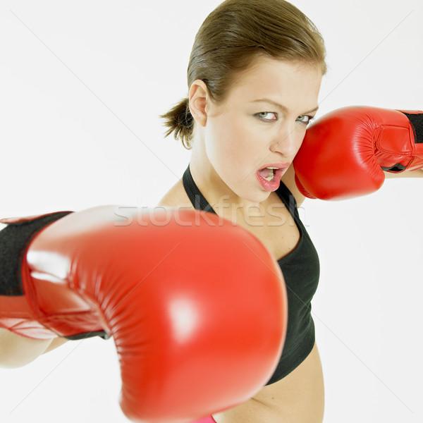 Vrouw bokshandschoenen sport oefening jonge opleiding Stockfoto © phbcz