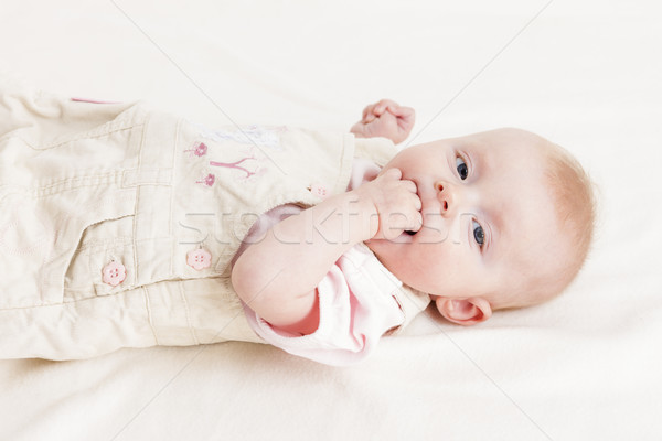 portrait of lying four months old baby girl Stock photo © phbcz