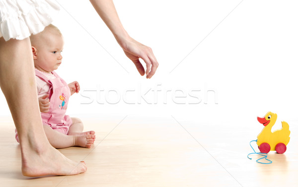 baby girl with a toy sitting on the floor Stock photo © phbcz