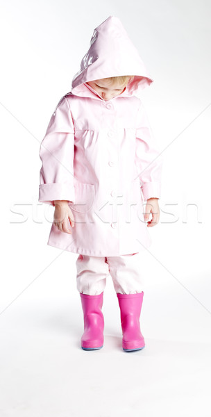 Petite fille imperméable fille mode enfant Photo stock © phbcz