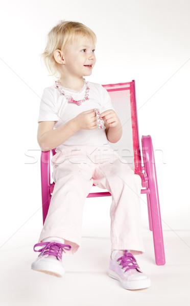 Kislány visel nyaklánc ül szék lány Stock fotó © phbcz