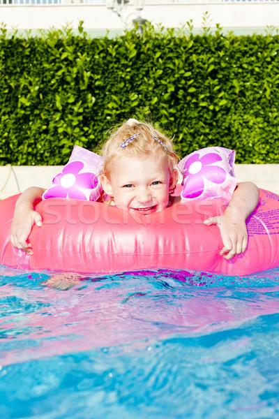 Küçük kız kauçuk halka yüzme havuzu su kız Stok fotoğraf © phbcz