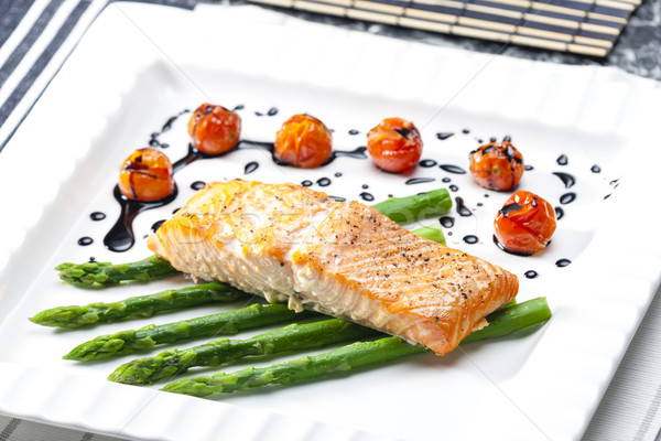 baked salmon with green asparagus and cherry tomatoes Stock photo © phbcz