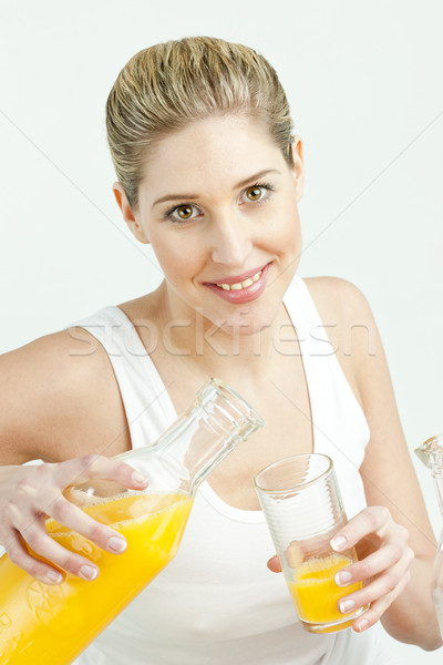 Portret jonge vrouw sinaasappelsap vrouwen glas jonge Stockfoto © phbcz
