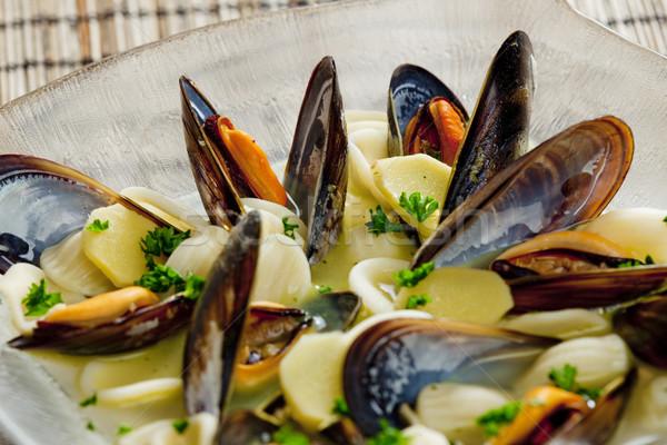 mussels soup with pasta orecchiette Stock photo © phbcz