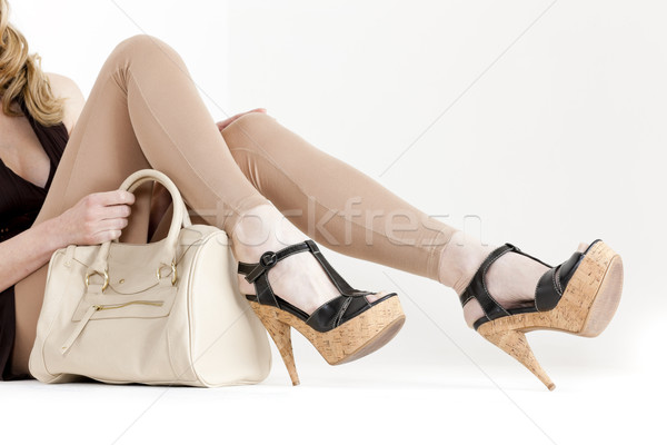detail of sitting woman wearing summer shoes with a handbag Stock photo © phbcz