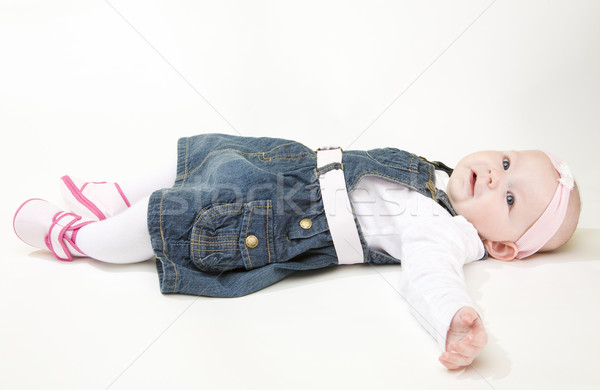 Stock photo: lying down baby girl