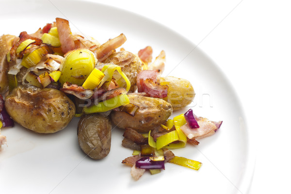 small potatoes baked with leek and bacon Stock photo © phbcz