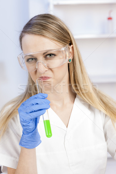 young woman doing experiment in laboratory Stock photo © phbcz