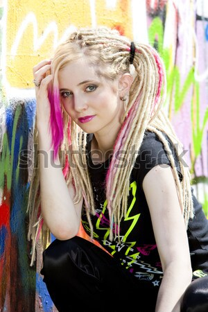 portrait of young woman standing at graffitti wall Stock photo © phbcz