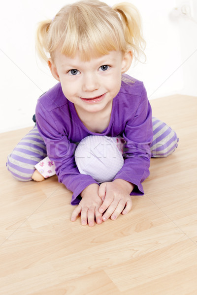 portrait of little girl playing with a doll Stock photo © phbcz
