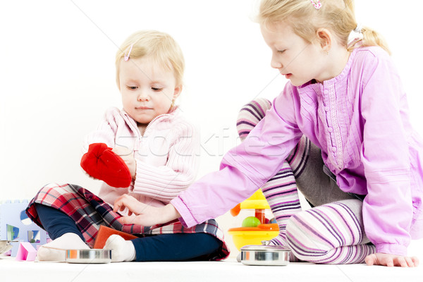 two little girls playing with child dish Stock photo © phbcz