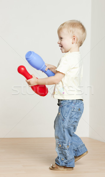 standing toddler girl playing with skittles Stock photo © phbcz