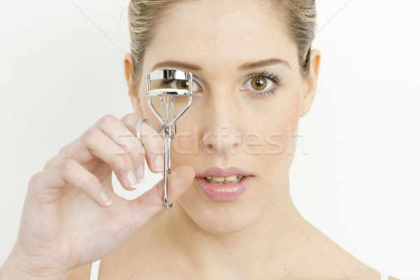 portrait of young woman making her eyelashes Stock photo © phbcz