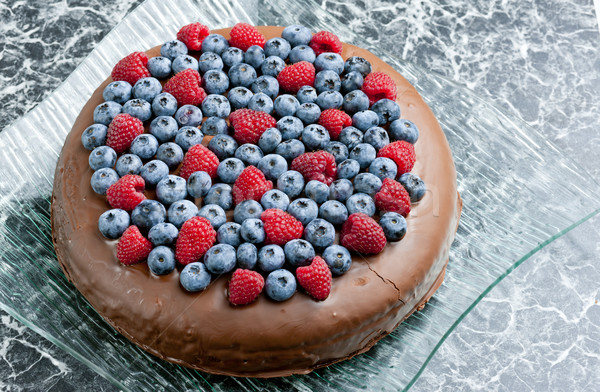 Foto d'archivio: Lamponi · mirtilli · alimentare · frutta · cioccolato
