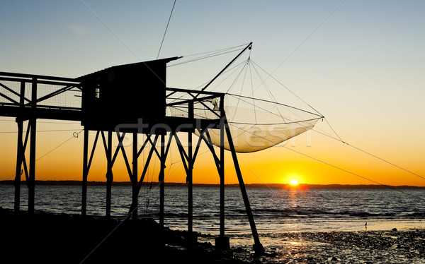 pier with fishing net during sunrise, Gironde Department, Aquita Stock photo © phbcz