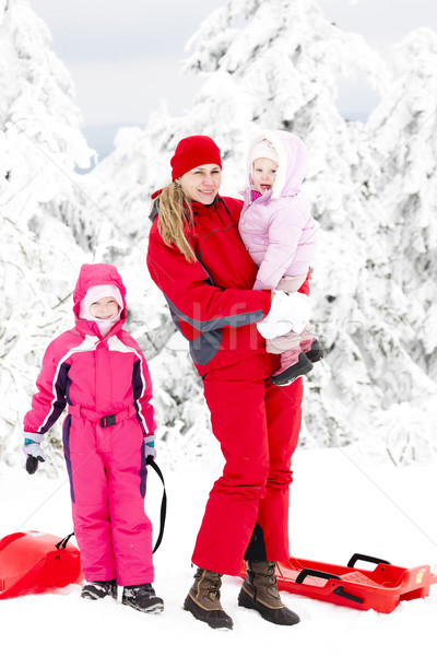 mother and her little daughters with bobs in snow Stock photo © phbcz