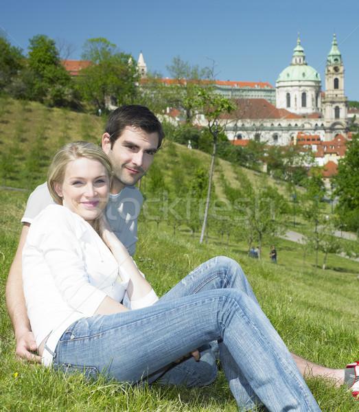 Stock photo: couple in Prague, St. Nicholas church, Prague, Czech Republic