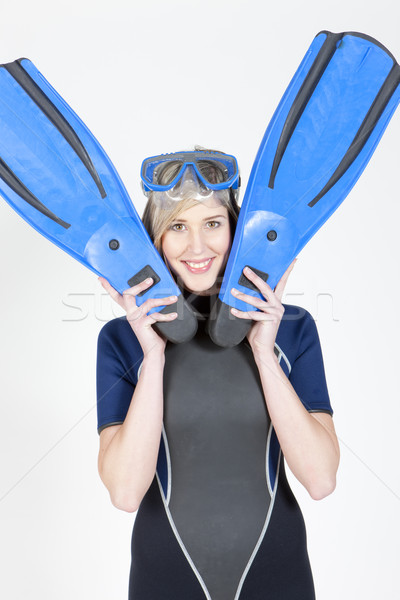 portrait of woman wearing neoprene with flippers and diving gogg Stock photo © phbcz