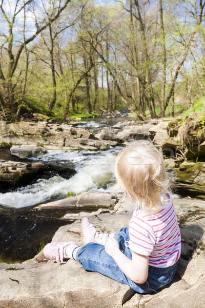 little girl sitting by Vyrovka brook, Czech Republic Stock photo © phbcz