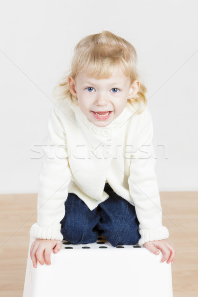 kneeling little girl wearing white sweater Stock photo © phbcz