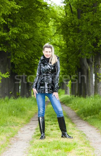 Mujer botas de goma primavera callejón moda Foto stock © phbcz