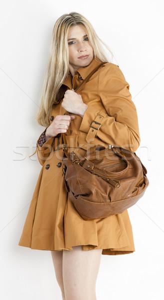 портрет Постоянный женщину коричневый пальто Сток-фото © phbcz