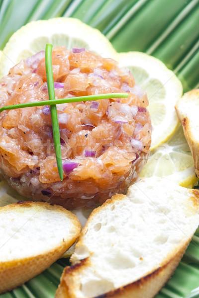salmon tartar with red onion Stock photo © phbcz