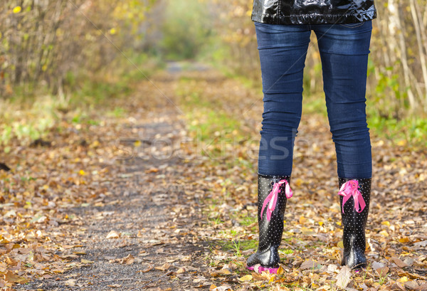 detail of standing woman wearing black rubber boots Stock photo © phbcz