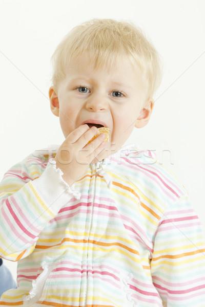 Retrato criança alimentação mandarim menina comida Foto stock © phbcz