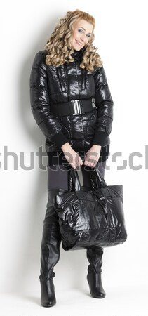 sitting woman wearing extravagant clothes Stock photo © phbcz