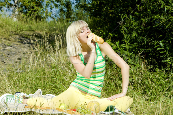 woman with a baguette at a picnic Stock photo © phbcz