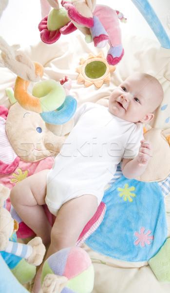 Kislány fekszik játszik gyerekek gyermek biztonság Stock fotó © phbcz