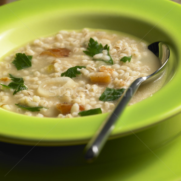 pot barley soup with pork meat pieces Stock photo © phbcz