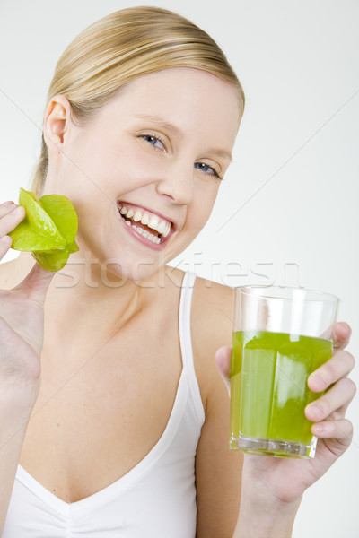 portrait of woman with a glass of juice and carambola Stock photo © phbcz