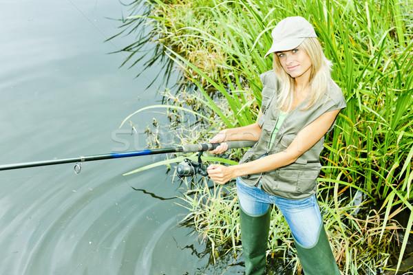Nő halászat tavacska sport női áll Stock fotó © phbcz