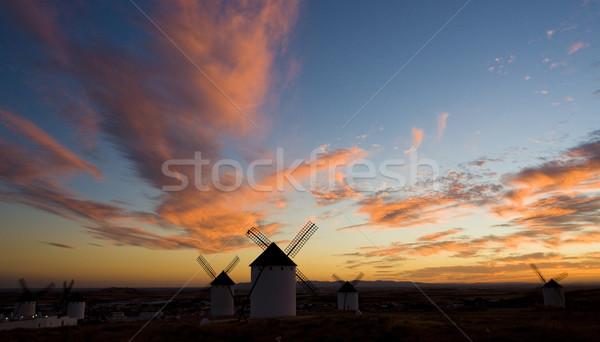 windmills at sunset, Campo de Criptana, Castile-La Mancha, Spain Stock photo © phbcz
