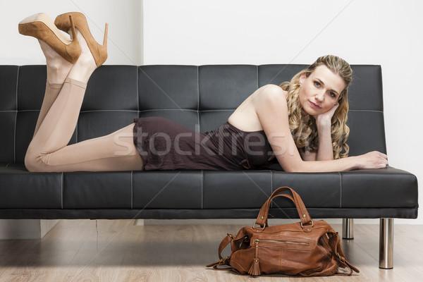 Femme sac à main canapé chaussures personne Photo stock © phbcz