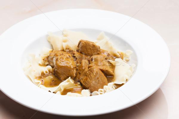 Varkensvlees stukken komijn pasta plaat maaltijd Stockfoto © phbcz
