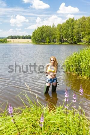 Młoda kobieta połowów staw lata kobieta bikini Zdjęcia stock © phbcz