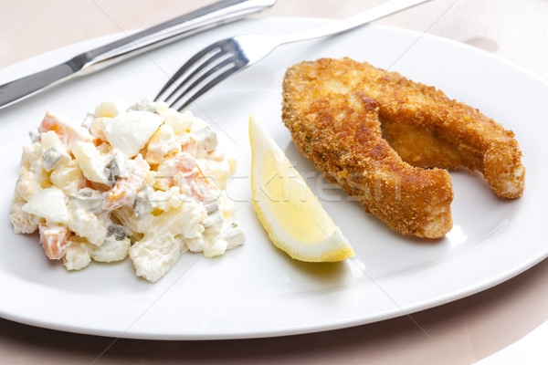 fried carp with potato salad Stock photo © phbcz