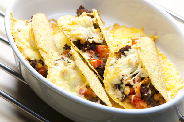 baked tacos filled with minced beef meat, beans and tomatoes Stock photo © phbcz