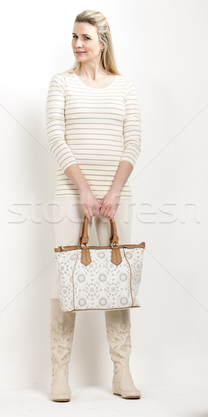 standing woman wearing summer boots with a handbag Stock photo © phbcz