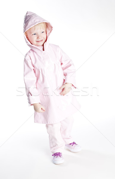 Kislány visel esőkabát lány gyermek rózsaszín Stock fotó © phbcz