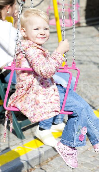 Stock photo: little girl on carousel