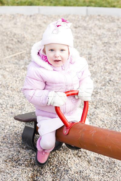 Küçük kız oturma salıncak kız çocuk kış Stok fotoğraf © phbcz