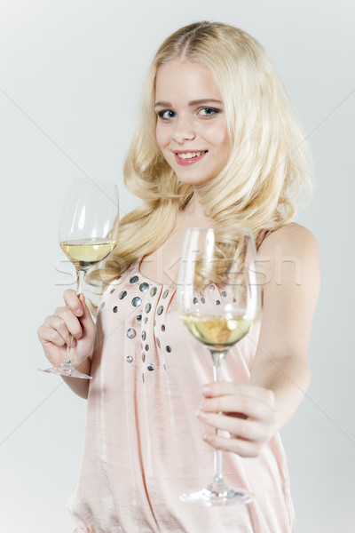 portrait of young woman with glasses of white wine Stock photo © phbcz