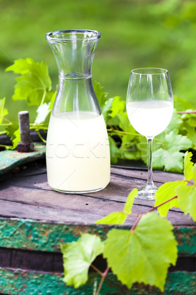 wine glass and carafe with wine cider standing on cask Stock photo © phbcz